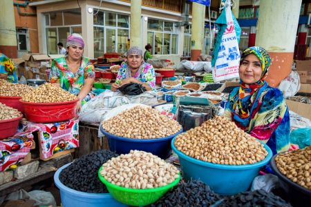 Tajik women selling nuts in Khujand bazaar
